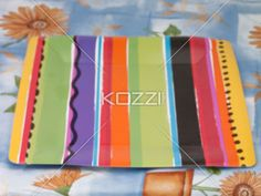 colorful rectangle plate - A colorful stripe rectangle plate on the top of the blue table cloth