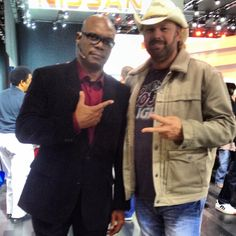 Samuel L. Jackson lookalike at the auto show 2014 with Toby Keith lookalike mike Sugg