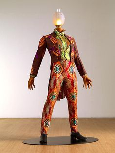 Yinka Shonibare, MBE (born 1962) is a disabled, British-Nigerian, contemporary artist living in the UK. Yink Shonibare, MBE was born in London in 1962. His family moved to Lagos, Nigeria when he was three. Shonibare contracted transverse myelitis at the age of seventeen. He returned to London to study Fine Art.