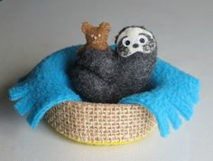 Sloth plush in basket with teddy bear and fleece blanket play