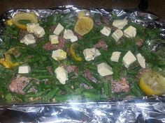 Lemon pepper chicken thighs with green beans baked in oven at 400 degrees.