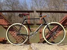 """I built this machine from parts ordered online worldwide in 'path racer' style common in the UK between World Wars I and II. This one is based a on a 1978 Raleigh DL1 Tourist 24"""" frame, backstay and fork."""