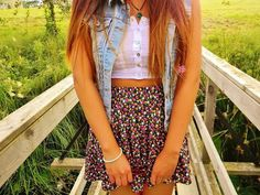 Jean jacket, crop top, with flowy skirt.