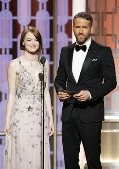 Emma Stone and Ryan Reynolds are seen onstage during the 74th Annual Golden Globe Awards.
