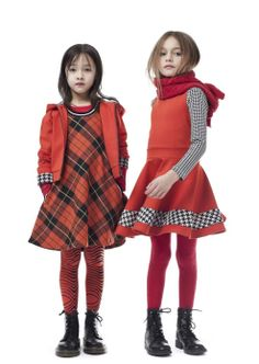 Plaids and Tartan checks combine with strong block red colour for children's fashion from Junior Gaultier winter 2012