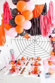 Fringe a f balloon garland! Pink, orange and black Ultimate KIDZ BOP Halloween Party | Kara's Party Ideas