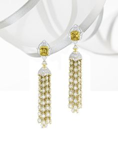Van Cleef  Arpels Pierres de Caractère Precious Light earrings in white and yellow gold with round and baguette-cut diamonds and two emerald-cut Fancy Vivid Orangy Yellow diamonds, 9.04ct total