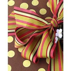 Combine striped ribbon with patterned wrapping paper without fear. Just make sure to use similar colors #giftwrap