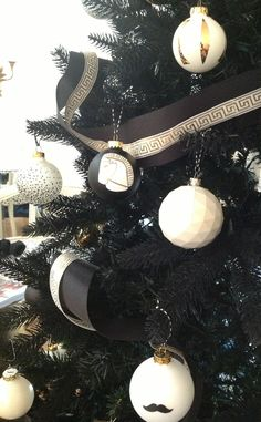 DIY Christmas ornaments on a black tree....we have to do the mustache one for Fred!!!
