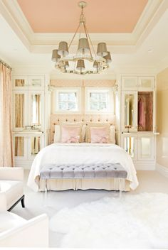 Love the built in mirrored closet space on sides of bed and love the pink & gold lining/paper on inside.***** Don't miss the pull out shelf to offer a night stand effect.