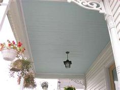 Haint blue ceiling.  Ours is Sherwin Williams 6505 Atmospheric satin paint.  So pretty with glossy white railings.