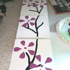 DIY canvas art!  Paint the bottom of a 2-liter bottle and stamp it on the canvas to make the flower shape.  Use black or brown paint to draw the branches.  So simple, yet so cute!!!
