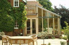 Oak frame conservatory with hidden balcony