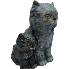 A vintage 1975 Goebel, W. Germany, mother cat with her baby kitty figurine. This pair is so sweet with mama cat done in a matte gray/blue color and