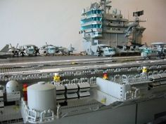Lego bricks can be used to construct nearly anything imaginable, from engines to aircraft carriers, sporting venues, cars, airplanes and spaceships. Lego Aircraft Carrier, Lego Space Station, Lego Boat, Lego Army, Amazing Lego Creations, Lego Ship, All Lego, Lego Worlds, Lego Design