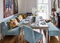 Kitchen Idea?.  Could you replace the old chairs with a long blue bench on one side and the upholsteres chairs on the other?  Home From Home - OKA