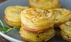 Parmesan and Rosemary Potato Stacks are an easy and delicious way to serve potatoes! cup unsalted butter, melted 1 tablespoon rosemary 1 teaspoon kosher salt fresh black pepper 4 small white or Yukon gold potatoes cup shredded Parmesan cheese Potato Sides, Potato Side Dishes, Vegetable Side Dishes, Vegetable Recipes, Rosemary Potatoes, Sliced Potatoes, Side Dish Recipes, Snack Recipes, Cooking Recipes