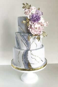 marble wedding cakes three tiered with golden elements and pink lilac flowers custom cakes toronto via instagram