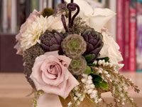 Beautiful autumn bridal bouquet with dahlias, roses, artichokes, pods and fern curls.