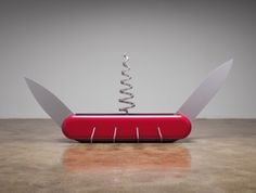 """Oldenburg/van Bruggen - Knife Ship 1:12 aluminum and mahogany wood, 8-1/2"""" x 40"""" x 9-1/2"""" (21.6 cm x 101.6 cm x 24.1 cm), closed without oars27-3/4"""" x 82-3/4"""" x 37"""" (70.5 cm x 210.2 cm x 94 cm), fully extended with oars (blades at 180 degrees; corkscrew at 90 degrees)32-3/4"""" x 40"""" x 37"""" (83.2 cm x 101.6 cm x 94 cm), p, Edition of 6, 2008, © Claes Oldenburg and Coosje van Bruggen, New York / Photo by: G. R. Christmas"""