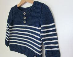 Thistle byLili Comme Tout is a simple boy's sweater we couldn't resist knitting in a classic, nautical style for summer. Though basic in form, thoughtful details like fake seams, slipp…