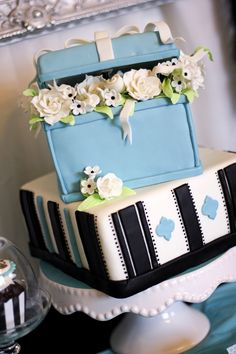 """The beautiful cake by 4 Kids Cakes was the main attraction,"" Jen says. ""It was as equally delicious as it was beautiful with delicate sugar flowers and fondant detailing. The cake was almost entirely edible from top to bottom."" Source: Banner Events"