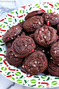 Mint Chocolate Pudding Cookies  1 cup unsalted butter, room temperature    3/4 cup dark brown sugar    1/4 cup granulated sugar    1 (3.4 oz.) package of chocolate fudge pudding mix    2 large eggs    1 tsp. vanilla extract    2 1/4 cups all purpose flour    1/4 cup Dutch-processed cocoa powder    1 tsp. baking soda    1/2 tsp. salt    1 cup Andes peppermint crunch baking chips