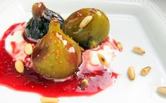 "Wine ""Poached"" Figs on Yougurt Creme (it's low-fat, shhhh!) Sticky sweet figs burst with flavor and freshness when paired with yogurt creme and crunchy pine nuts!  The wine used in the steaming liquid and then reduc"