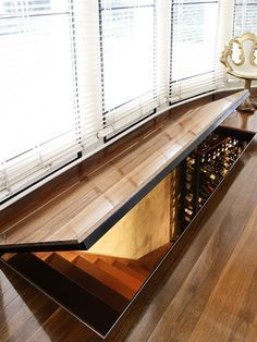 A secret hatch! An ingenious entry point to the basement cellar. See original image at http://www.michaelbellarchitects.com/residential-5/residential-5-picture-2/