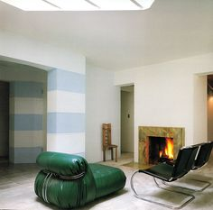 white walls, baby blue stripes, overstuffed green leather chair, wood, chrome, leather, marble, fire aqqindex:  Eric Owen Moss, Petal House, 1981-1983