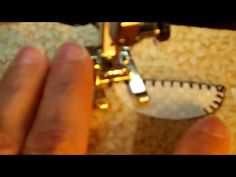 blanket stitch applique youtube.  has 2 great tips: 1) pull bobbin thread up and to the back, 2) straight stitch to travel to next blanket stitch location.  may be out of focus but very useful.