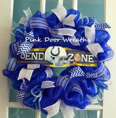 1 Deco Mesh INDIANAPOLIS COLTS wreath    Made with blue deco mesh and accented with lots of blue and white to showcase the team sign in the