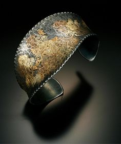 """FeAuAutumn"" cuff bracelet. Textured iron fused with 12karat Egyptian electrum, 18karat red gold, and 20karat gold.  Chris Nelson - Goldsmith at urban-armour"