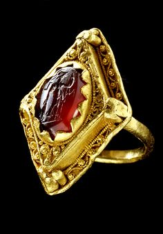An Anglo Saxon ring found in an English garden. The stone is a Roman intaglio showing Mars; the body probably a 8th Century brooch; and the shaft a 10th C addition - so the experts say.