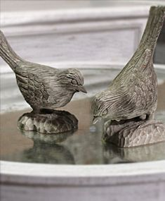 Cute Decorative Objects to add a touch of nature to your space. Hand Carved Finches!