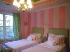 Little girls pink striped room with green accents