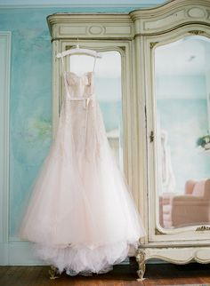 Whether it's hanging in front of a window or from a bedpost, the dress deserves to be captured in its full glory.  Photo by Jen Fariello Photography via Style Me Pretty