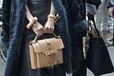 Love the bag and bracelets together.