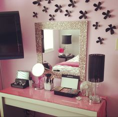 makeup table inspiration. Love the mirror and the wall flowers.