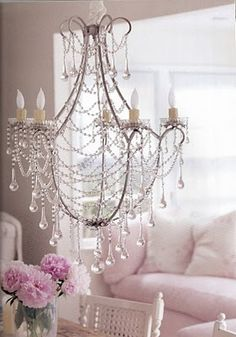 I am longing for a gorgeous chandelier just dripping crystals.      Styling by Rachel Ashwell