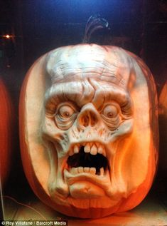 Sculptor Ray Villafane and his team meticulously shaped the terrifying characters from pumpkins using spoons and scalpels..