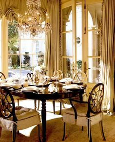 Beautiful dining room where the drapes match the chair slip covers