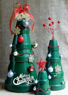 Gather terra cotta pots, spray paint and extra holiday ornaments to craft this creative Christmas tree. You choose the size of the tree to be desktop-, tabletop- or front porch-worthy. From The Home Depot's Garden Club. Christmas Clay, Diy Christmas Tree, Homemade Christmas, Christmas Decorations, Christmas Ornaments, Flower Pot Art, Flower Pot Design, Flower Pot Crafts, Potted Christmas Trees