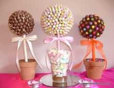 A trio of super chocolate candy trees. Chocolate malt balls, suger coated eggs or chocolate cups and choc beans. who do you know that would love one of these?