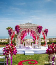 Weddings are a celebratory occasion which brings together two families. Confused whether to decorate your wedding mandap using florals or lights? We have curated a list with some awe-inspiring Wedding Mandap decor inspirations we know you'll love. Wedding Ceremony Ideas, Desi Wedding Decor, Wedding Hall Decorations, Marriage Decoration, Wedding Mandap, Wedding Centerpieces, Wedding Boquette, Beach Decorations, Wedding Arrangements