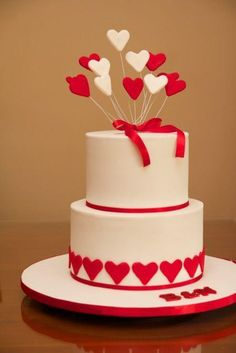 2 tier red, white and heart themed engagement cake