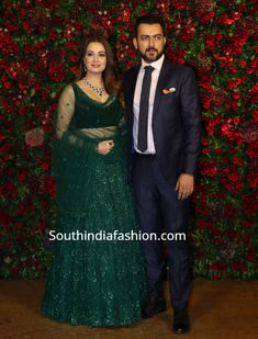 Dia Mirza wore an emerald green lehenga by Kresha Bajaj to Deepika and Ranveer's wedding reception. Diamond emerald necklace and earrings set by Mahesh Notandass and soft curls rounded out her look! Indian Bridal Outfits, Indian Designer Outfits, Pakistani Outfits, Lehnga Blouse, Bridal Lehenga Choli, Wedding Lehenga Designs, Kurti Designs Party Wear, Bride Reception Dresses, Lehenga Reception