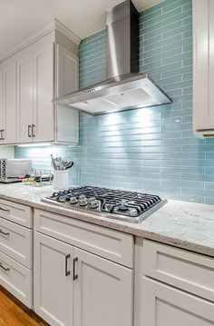 The Reflective Quality Of This Kitchens Blue Glass Tile Backsplash Is A Perfect Compliment To The Crisp Sophistication Of Its Stainless Steel High End