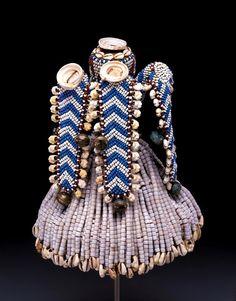 Africa   Prestige hat (kalyeem). Kuba peoples. Democratic Republic of the Congo   Raffia, glass beads, cowrie shells, conus shells, cotton textile, and brass   early 20th century