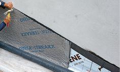 Pose d'une nappe drainante sur une mur vertical (DELTA-TERRAXX par Doerken)